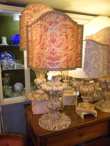 A carved wooden lamp base with a fantastic Fortuny shade